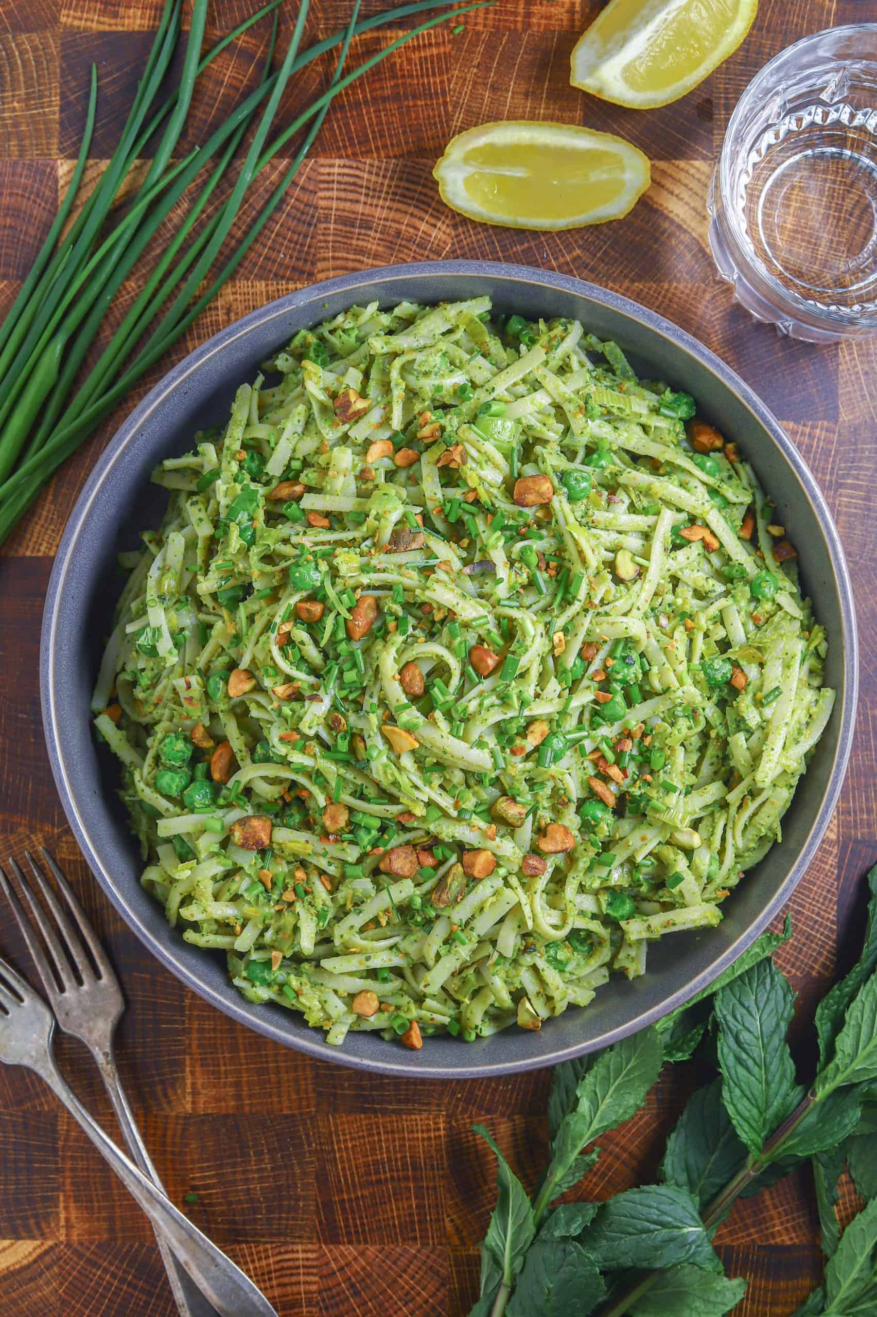 green pea pasta in a bowl with mint