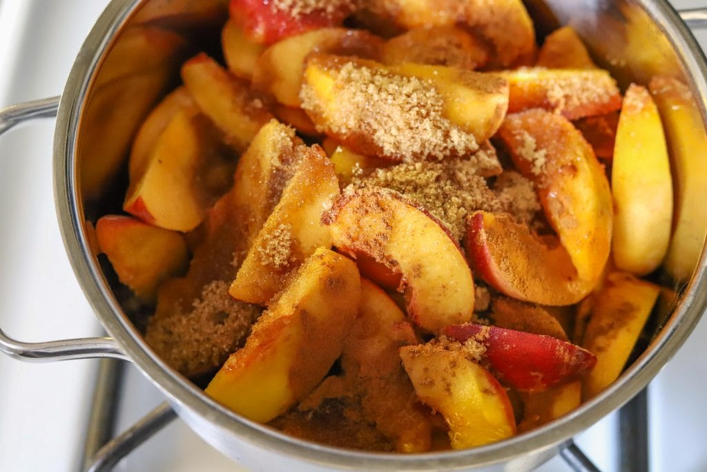peaches in a pot with sugar and spices