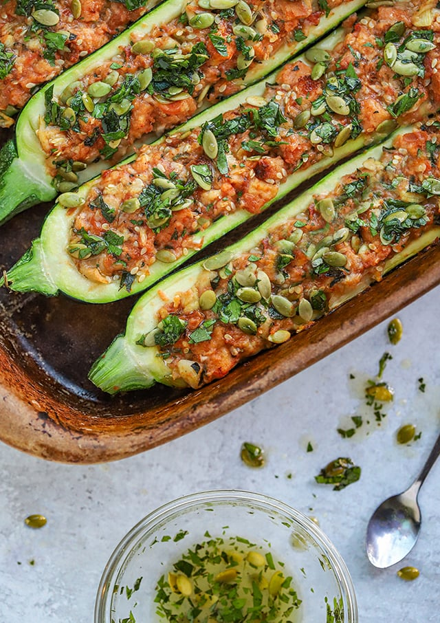 stuffed zucchini in a dish with herbs