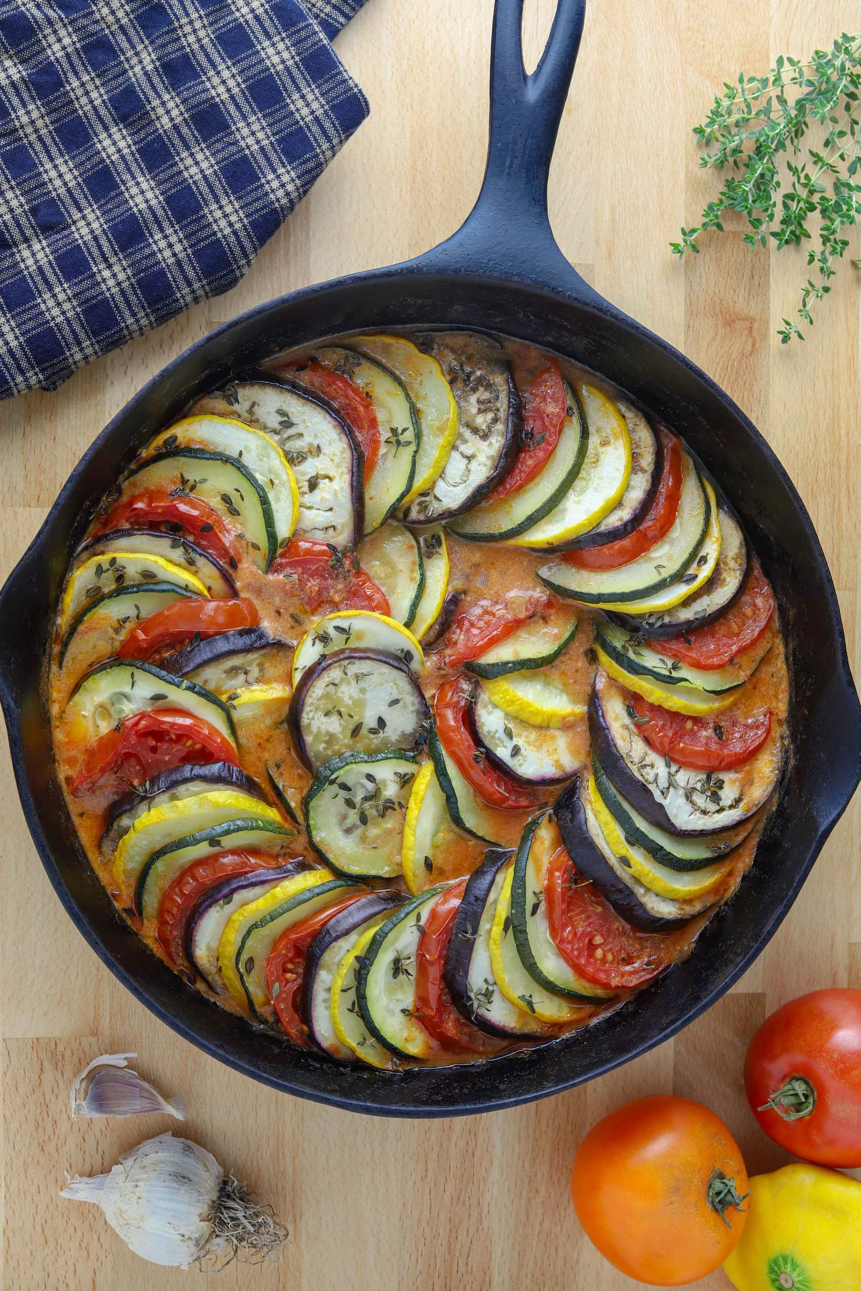 cast iron pan with ratatouille stew on counter