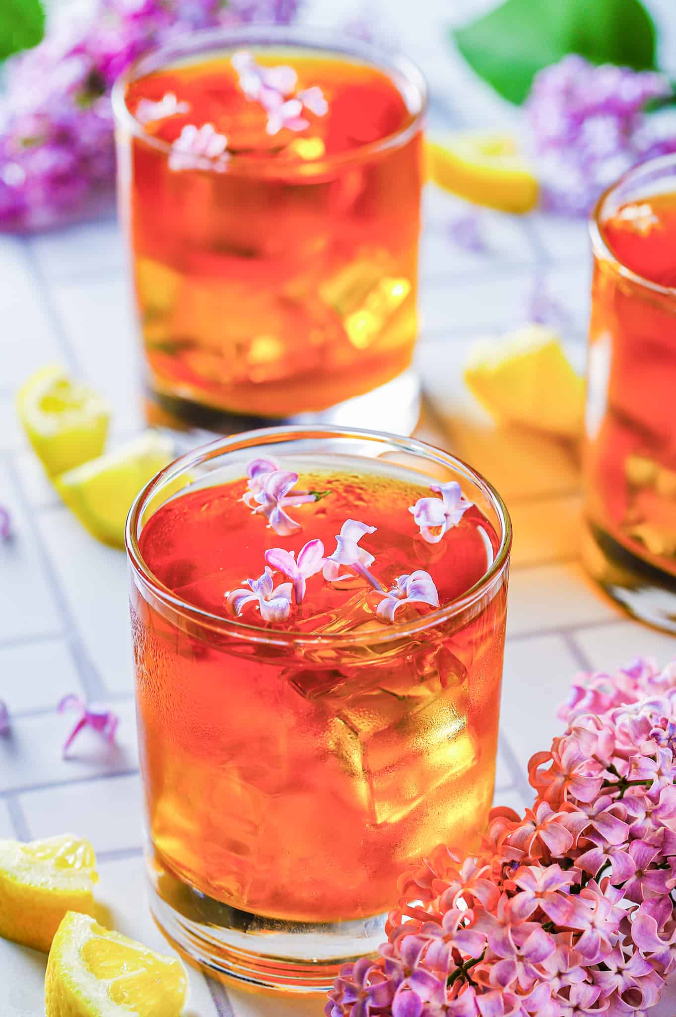 lilac tea in glasses with lilac flowers