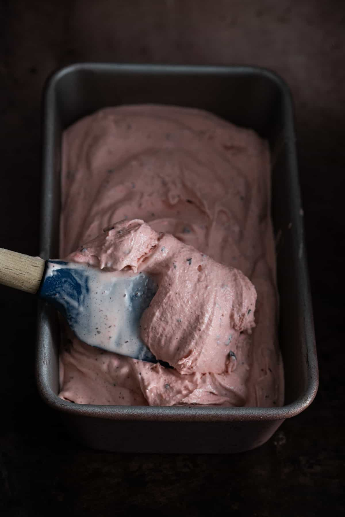 spreading ice cream out in a tin for freezing