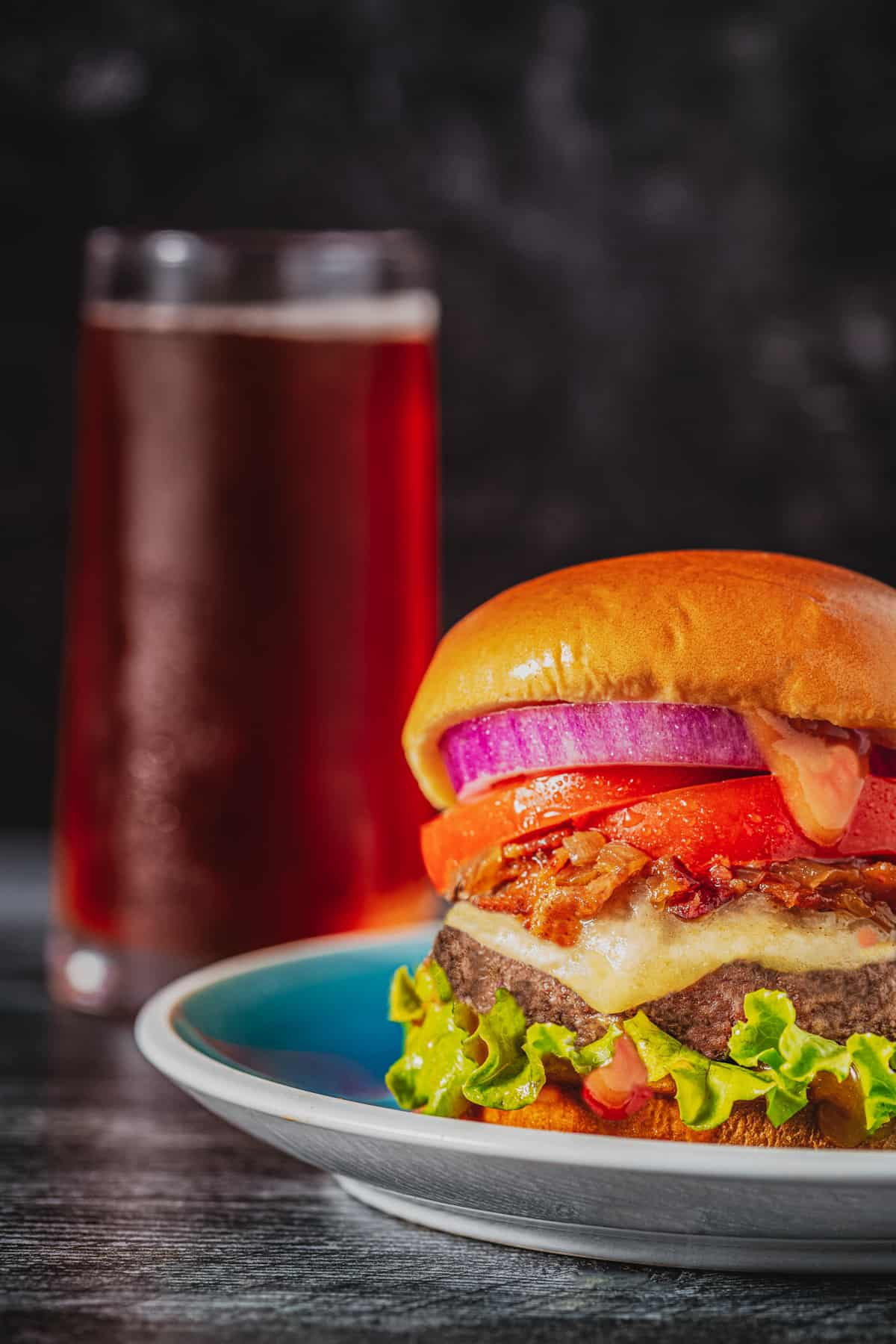 peanut butter burger on plate with bacon jam and bun