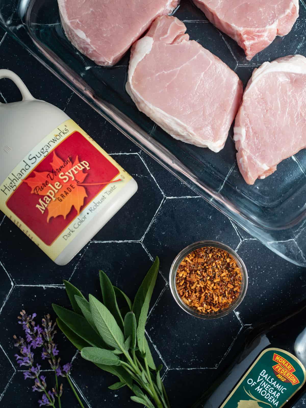 pork chops, maple syrup, grill seasoning, herbs and balsamic vinegar